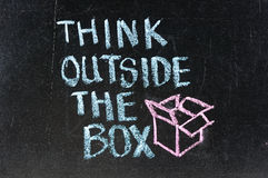 Think outside the box. On chalk board Stock Image