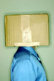 Think outside the box. Man thinking in the box Royalty Free Stock Photo