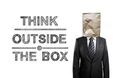 Think outside the box. Businessman with paper bag and drawing think outside the box royalty free stock photos