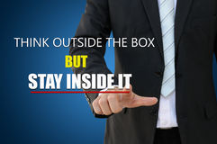 Think outside the box. Businessman pointing think outside the box stock photo