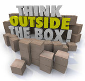 Think Outside the Box Cardboard Boxes Original Thinking. Think Outside the Box 3d words surrounded by cardboard boxes to illustrate original ideas, creativity Royalty Free Stock Photos