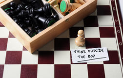 Think outside the box. Chess box - think outside the box concept stock photos