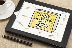 Think outside the box concept. Think outside the box - sketch on digital tablet  with a coffee cup and stylus pen Royalty Free Stock Photo