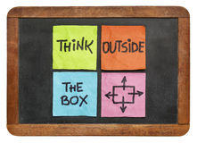 Think outside the box concept. Colorful sticky notes on a vintage slate blackboard  isolated on white Royalty Free Stock Images