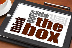 Think outside the box. Concept on a digital tablet with cup of tea Stock Photos