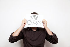 Think outside the box face Royalty Free Stock Photo