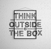 Think outside the box. Frames with  think outside the box on brick wall Stock Photos