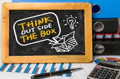 Think outside the box hand drawing on blackboard Stock Photos