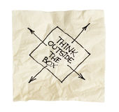 Think outside the box on a napkin Stock Photo