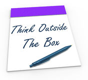 Think Outside The Box Notepad Means Unique. Think Outside The Box Notepad Meaning Unique Thoughts Stock Photo