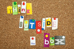 Think Outside The Box. Single letters pinned on cork noticeboard Royalty Free Stock Photo