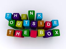 Think outside the box. Spelled in colorful blocks isolated on white Royalty Free Stock Photo