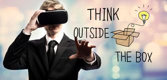 Think Outside The Box text with businessman using a virtual reality Royalty Free Stock Images