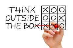 Think Outside The Box Tic Tac Toe Concept. Hand sketching Think Outside The Box tic-tac-toe game concept with marker on transparent wipe board Stock Photography