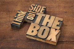 Think outside the box. Word abstract in letterpress wood type on a grunge wooden surface royalty free stock photo