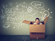Think outside box. Young woman coming out of box. Think outside the box concept. Young woman coming out of box isolated on info graphic gray wall background stock photo