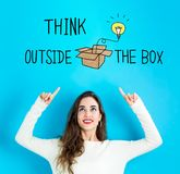 Think Outside The Box with young woman looking upwards. Think Outside The Box with young woman reaching and looking upwards Royalty Free Stock Images