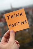 Think positive. Thinking positive with city background