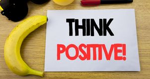 Think Positive. Business concept for Positivity Attitude written on sticky note empty paper, wooden background with copy space, su. Think Positive. Business royalty free stock images