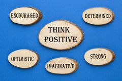 Think Positive Concept. Wooden ellipse with text THINK POSITIVE with keywords Determined, Strong, Imaginative, Optimistic and Encouraged royalty free stock photos