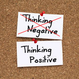 Think positive, do not negative. Think positive concept pinned on cork noticeboard Stock Image