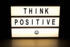 Think positive light box sign board stock photo