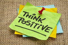 Think positive. Motivational reminder - handwriting on sticky note royalty free stock photography