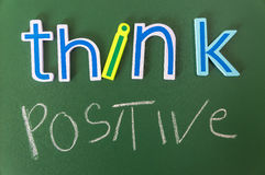 Think positive or negative. Colorful words on blackboard Stock Photo