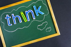 Think positive or negative. Colorful words on blackboard Royalty Free Stock Photo