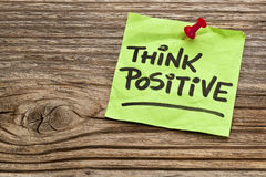 Think positive reminder. Note against grained weathered wood Royalty Free Stock Images