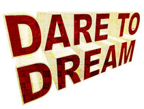 Dare to dream. An Illustration of 3-d 3D Dare to dream statement sign.  Image isolated over white background Royalty Free Stock Images