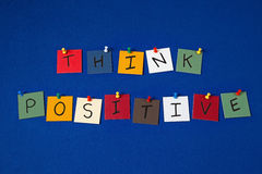 THINK POSITIVE - sign on noticeboard for business, Stock Image