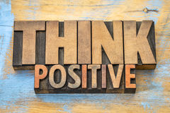 Think positive word abstract in wood type royalty free stock photos