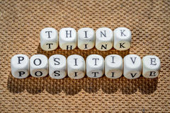 Think positive. Words made from toy cubes with letters Royalty Free Stock Image