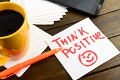 Think positive writing on white napkin Royalty Free Stock Image