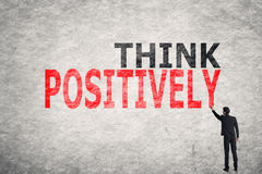 Think Positively. Asian businessman write text on wall, Think Positively Stock Photography