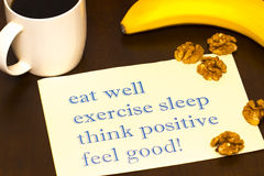 Think positively , exercise, eat well, sleep - concept feel good. Handwriting on a sheet of paper Royalty Free Stock Photos