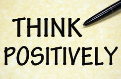 Think positively symbol. Written with pen on paper Stock Photography