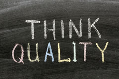 Think quality. Phrase handwritten on school blackboard Stock Photography