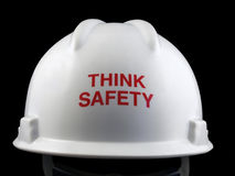 Think Safety Hard Hat. Think safety message on the back of a hard hat Stock Photo