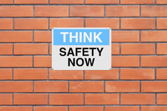 Think Safety Now. A sign with a safety reminder Stock Photos