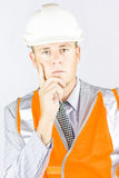 Think Smart And Work Safe. Business Man In High Vis Clothing And Hard Hat Takes Five Minutes To Do A Site Assesment In A Think Smart And Work Safe Concept Stock Image
