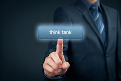 Think tank. Concept. Businessman click on virtual button with text Royalty Free Stock Images