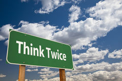 Think Twice Green Road Sign Stock Image