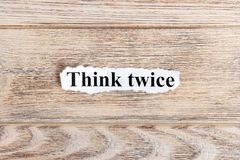 Think twice text on paper. Word Think twice on torn paper. Concept Image Stock Photo