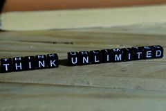 Think unlimited on wooden blocks. Motivation and inspiration concept royalty free stock photos
