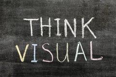Think visual. Concept phrase handwritten on the school blackboard stock image