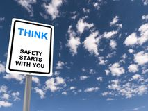 Think sign. White roadside style sign on a post with text 'think  safety starts with you' in uppercase letters with 'think' emphasized in larger blue letters Stock Photography
