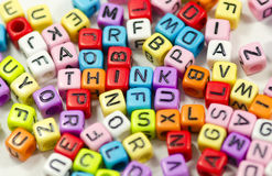 Think. Word Think using colorful alphabets beads royalty free stock photos