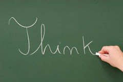 Think written on a blackboard. With chalk Royalty Free Stock Image